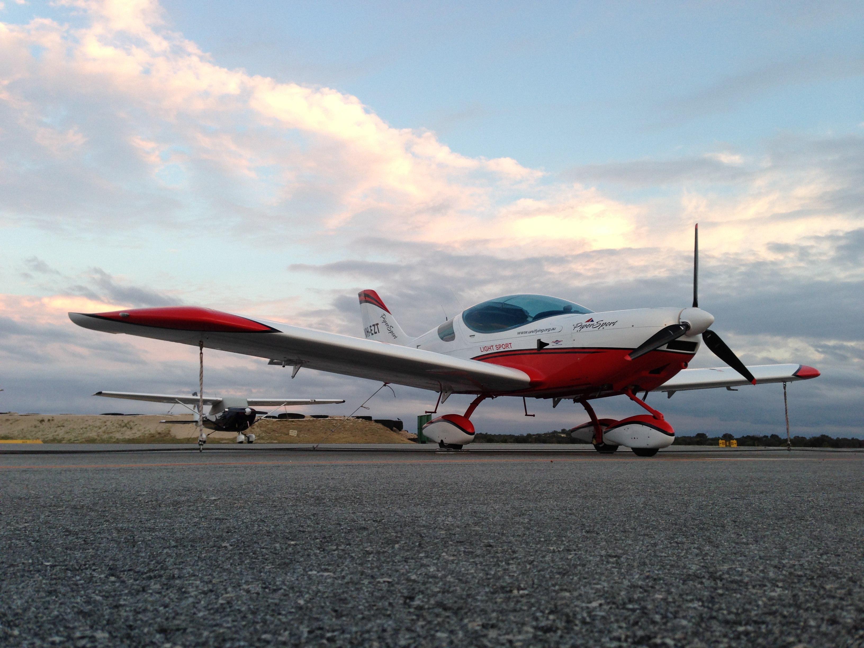 VH-EZT CSA pipersport sportscruiser parked at jandakot sunset
