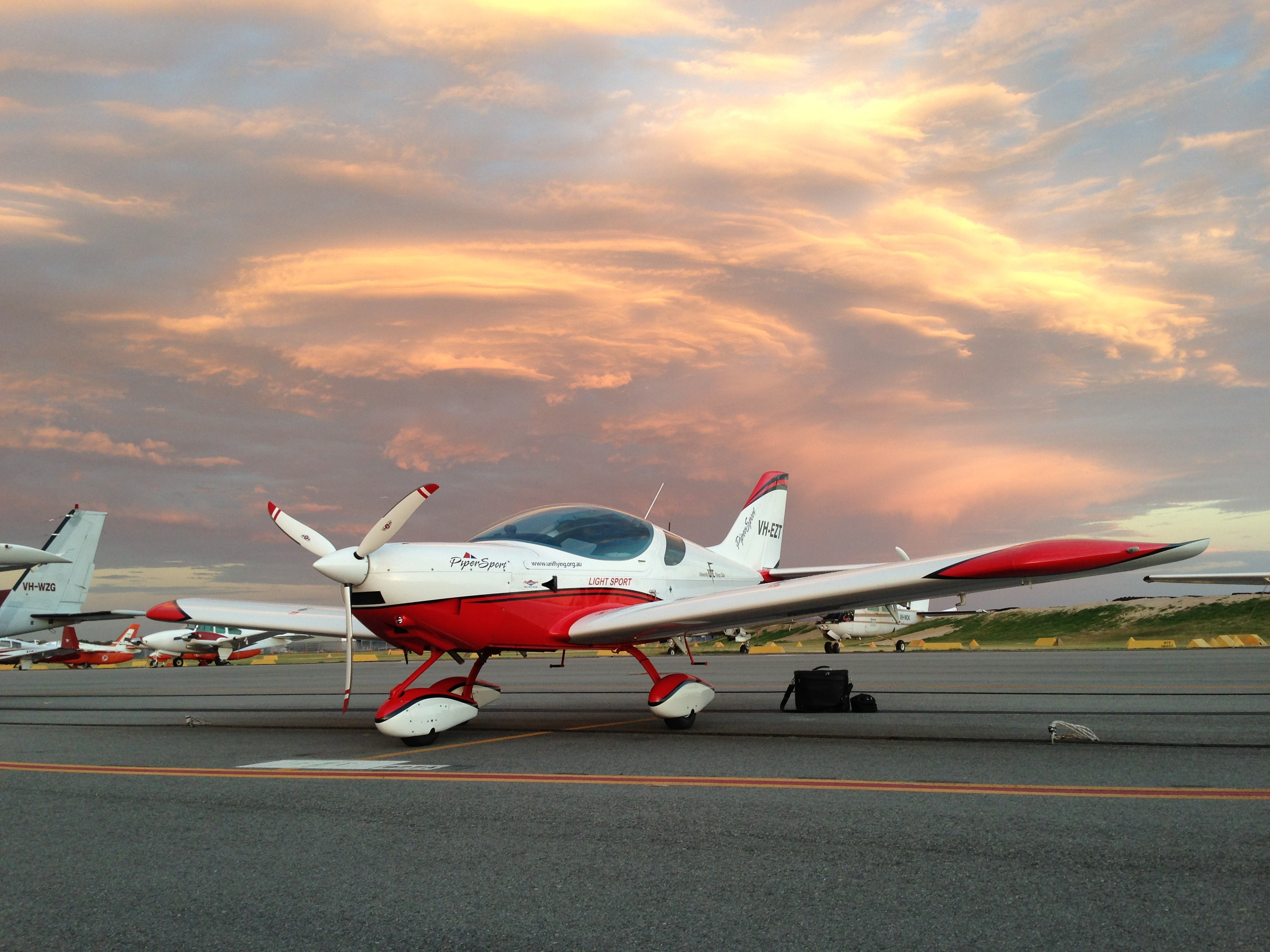 VH-EZT CSA pipersport sportscruiser learn to fly parked at jandakot near jandakot flight centre sunset