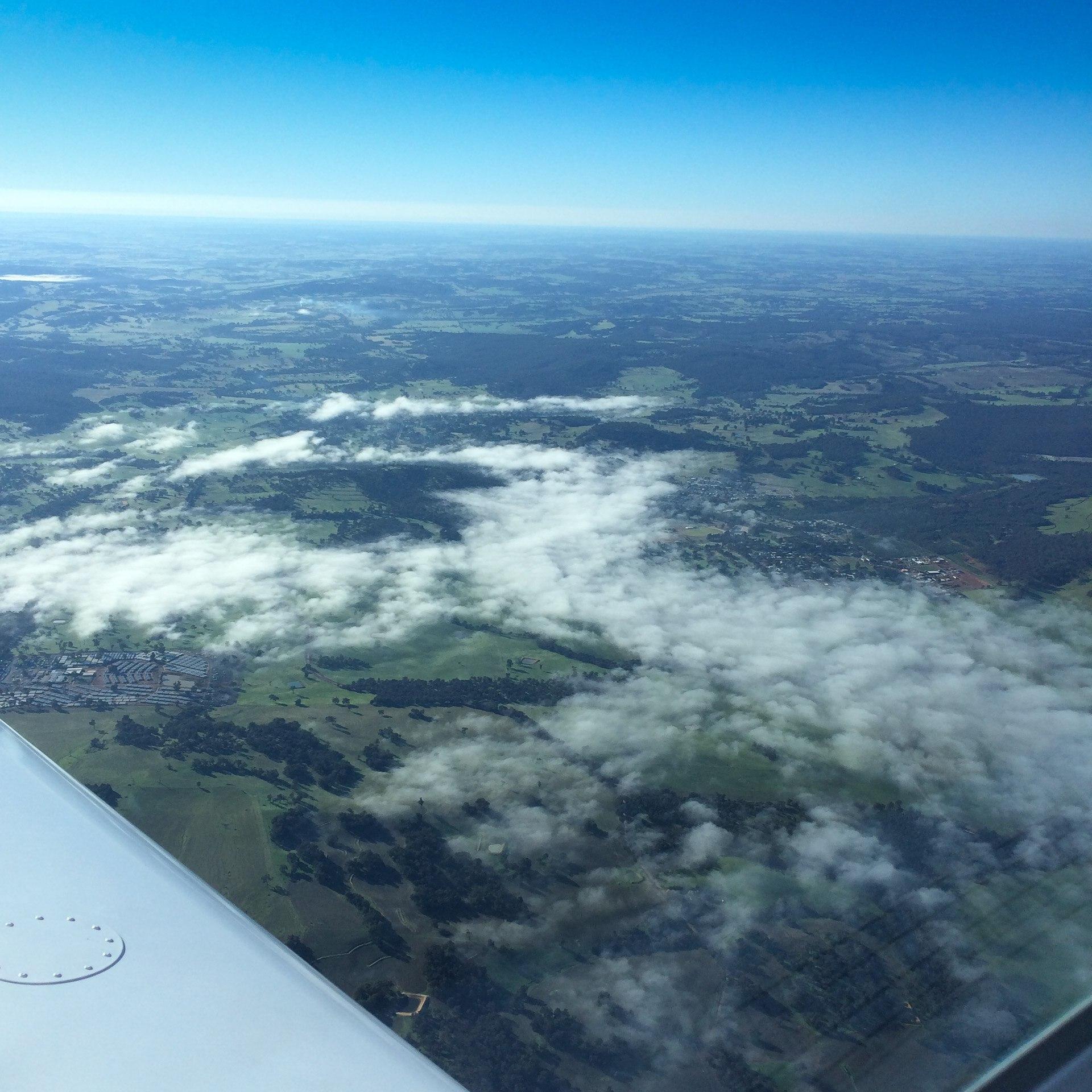 clouds from the air vh-ezt UFC uni flying club jandakot learn to fly aircraft hire