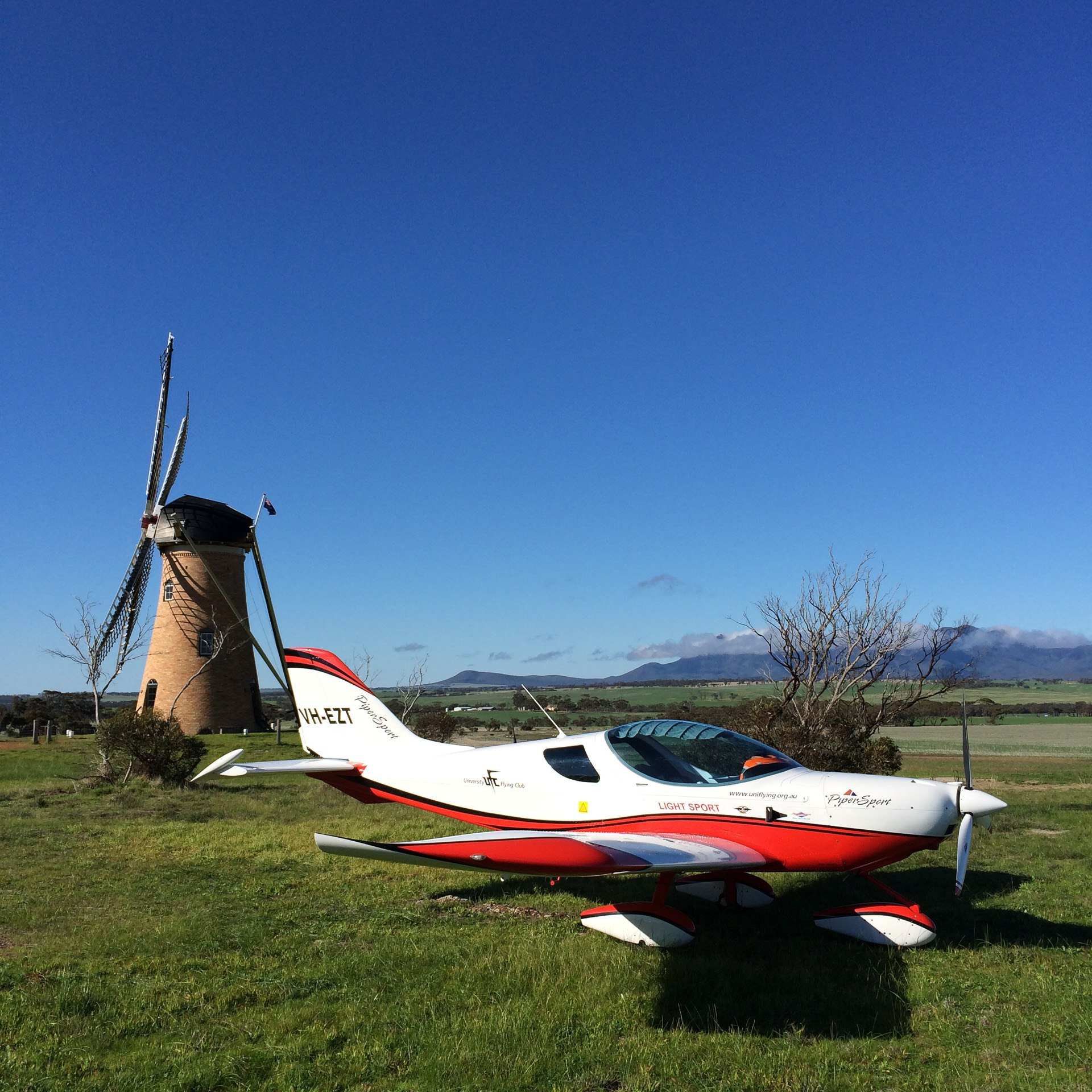 VH-EZT at the lily dutch windmill runway airstrip